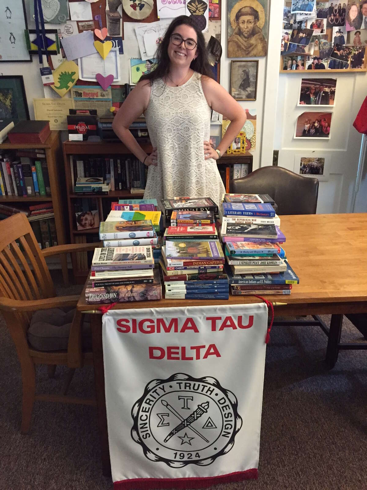 Alpha Alpha Sigma, the Russell Sage College chapter of Sigma Tau Delta, the English Honor Society, has sent out about 160 books for middle school students to Rural America Initiatives in Rapid City, S.D. Seen here is Kelly Shanahan, Sigma Tau Delta president at Russell Sage. Faculty advisor is Professor David A. Salomon, who previously taught in South Dakota. The non-profit group's mission is to partner with whole families to help American Indian children and youth acquire tools to thrive in the contemporary environment and to support their cultural values. The website is http://www.ruralamericainitiatives.org/