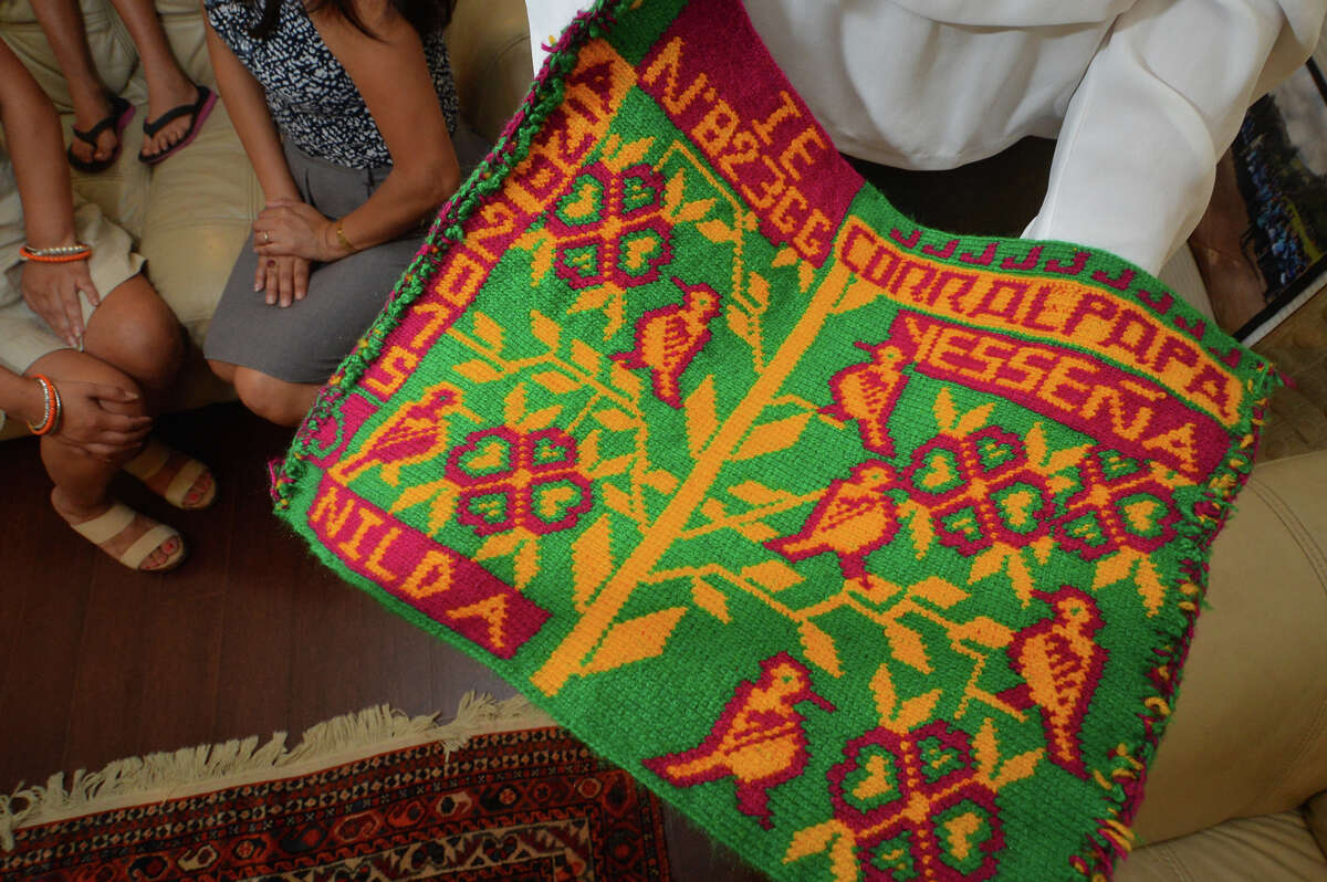 A handmade tapestry with Jessenia's name, from a school in Corralpapa Peru to say thanks for the Ready for School program she founded.