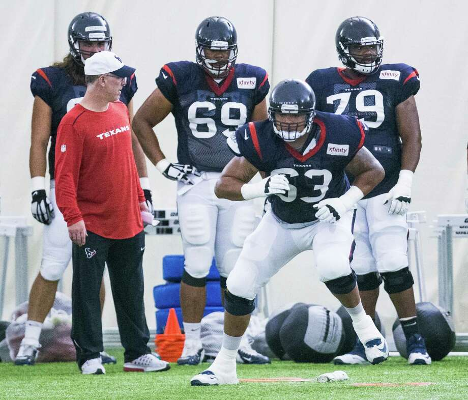 Texans tackle Kendall Lamm (63) runs a blocking drill during training camp this week. While filling in for an  injured Derek Newton, Lamm is trying to soak up as much knowledge as possible. Photo: Brett Coomer, Staff / © 2016 Houston Chronicle