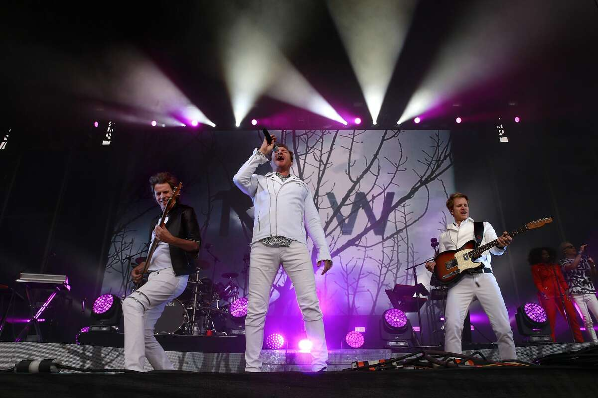 Singer Simon Le Bon, (center) John Taylor, (left) on bass and Andy Taylor on guitar and of Duran Duran as they perform on the Lands End stage during day one of the Outside Lands Music Festival in Golden Gate Park in San Francisco, California, on Fri. Aug. 5, 2016.