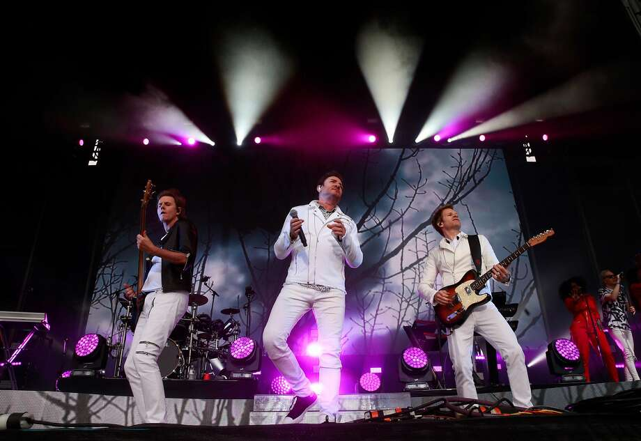 Singer Simon Le Bon, (center) John Taylor, (left) on bass  and Andy Taylor on guitar and of Duran Duran as they perform on the Lands End stage  during day one of the Outside Lands Music Festival in Golden Gate Park in San Francisco, California, on Fri. Aug. 5, 2016. Photo: Michael Macor, The Chronicle