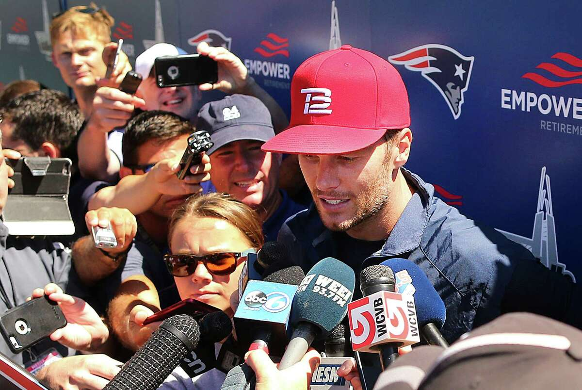 New England Patriots quarterback Tom Brady speaks to media at football training camp, Friday, Aug. 5, 2016, in Foxborough, Mass. Brady said his decision not to pursue his appeal of a four-game suspension in the
