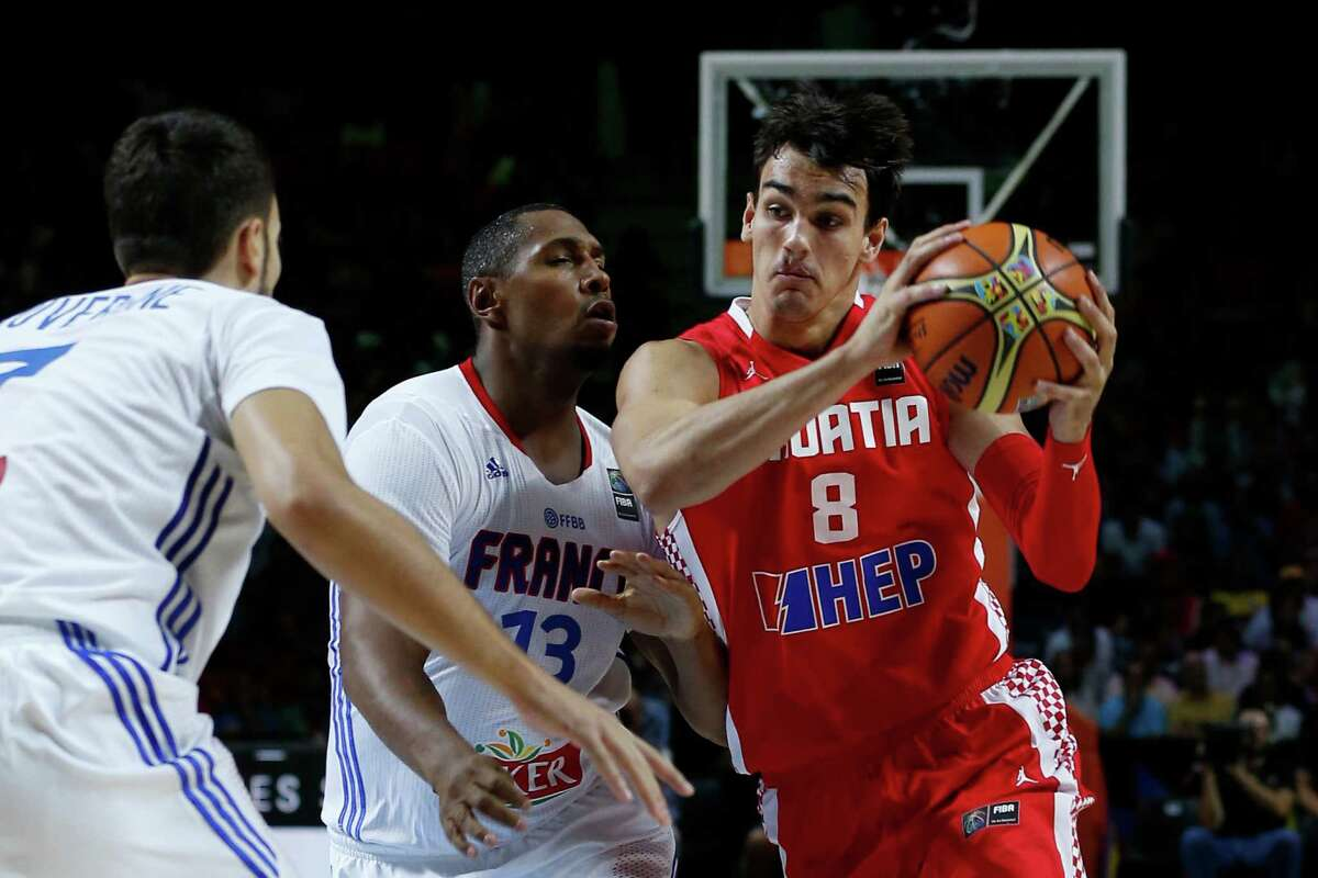 FILE - In this Sept. 6, 2014, file photo, Croatia's Dario Saric, right, drives the ball against France's Boris Diaw, center, and Joffrey Lauvergne during the World Cup Round of 16 match between Croatia and France in Madrid, Spain. From Kyrie to KD, DeMar to DeMarcus, the players on the U.S. basketball team are so well known that they can simply go by nicknames or first names. But there are plenty more players who either are, or soon might be, familiar to NBA fans watching the Olympics. Here?'s a look at a few of them, players like Dario Saric (Croatia), Willy Hernangomez (Spain) and Yi Jianlian (China), as competition begins Saturday. (AP Photo/Daniel Ochoa de Olza, File) ORG XMIT: NY168
