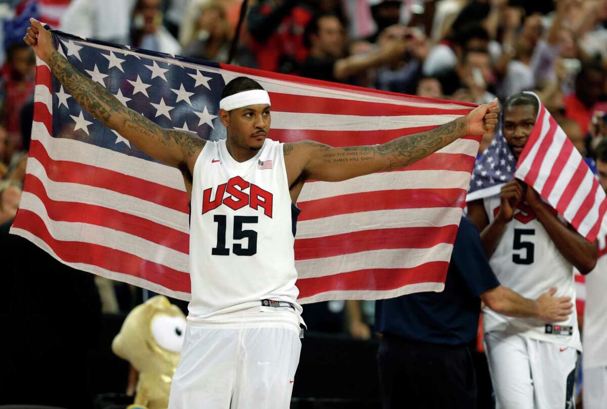 FILE - In this Aug. 12, 2012, file photo, United States' Carmelo Anthony celebrates after the men's gold medal basketball game at the 2012 Summer Olympics, in London. With two Olympic gold medals and a chance to be the first men?'s player to win three, Anthony has become the unlikely face of USA Basketball, a rise that couldn?'t have been imagined 12 years ago. (AP Photo/Charles Krupa, File) ORG XMIT: NY178