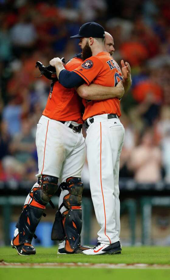 Aug. 5: Astros 5, Rangers 0Houston Astros starting pitcher Dallas Keuchel (60) hugs catcher Evan Gattis (11) as they celebrated after the Astros 5-0 win over the Texas Rangers during an MLB game at Minute Maid Park, Friday, Aug. 5, 2016, in Houston. Photo: Karen Warren, Houston Chronicle / © 2016 Houston Chronicle