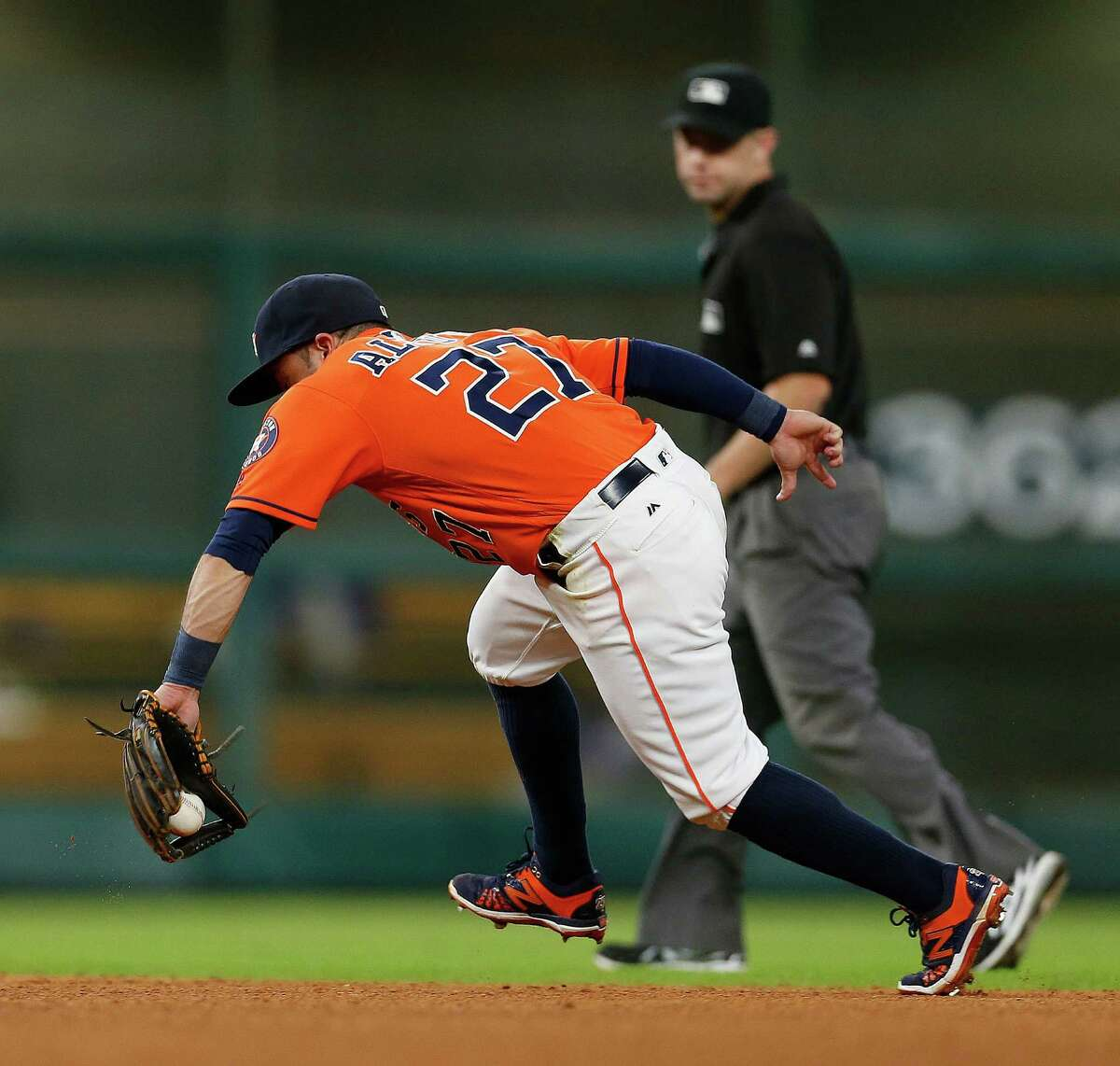 Houston Astros second baseman Jose Altuve (27) fields Texas Rangers Shin-Soo Choo's ground ball during the sixth inning of an MLB game at Minute Maid Park, Friday, Aug. 5, 2016, in Houston.