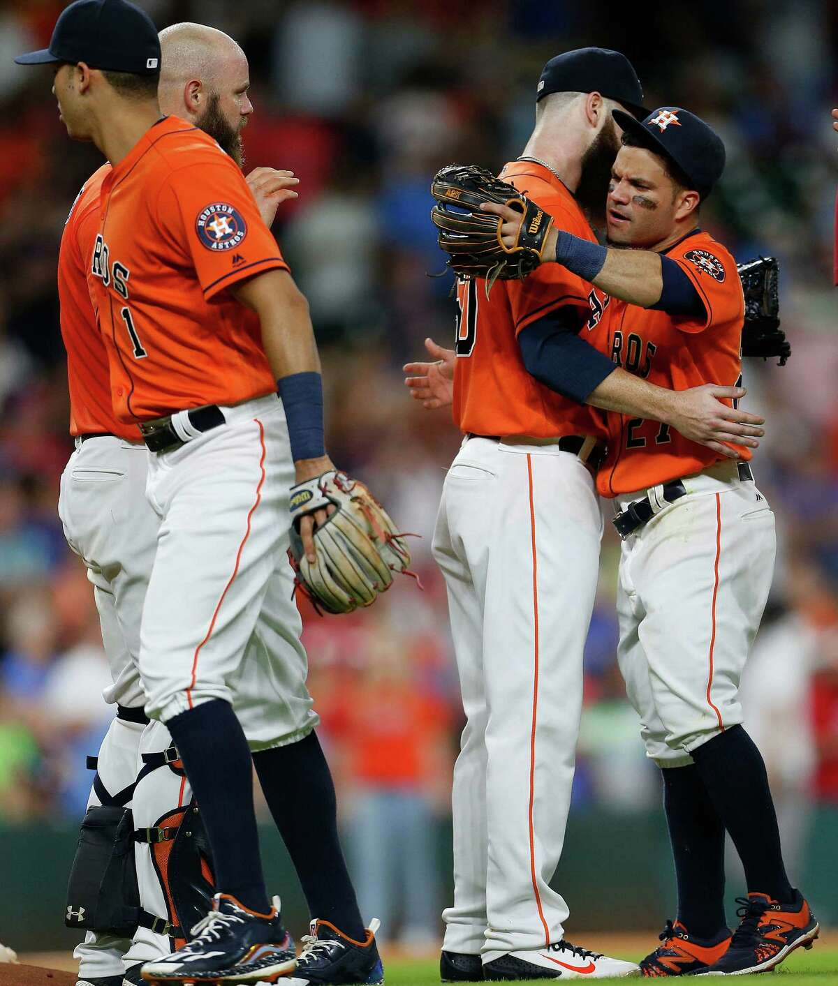 Houston Astros starting pitcher Dallas Keuchel (60) hugs Jose Altuve as they celebrated after the Astros 5-0 win over the Texas Rangers during an MLB game at Minute Maid Park, Friday, Aug. 5, 2016, in Houston.