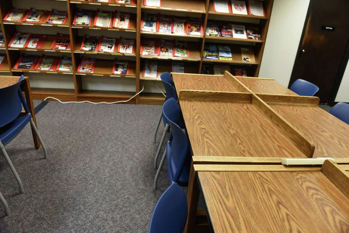 Power cords leading to power strips on desks are seen coming out of shelving in computer room at the William K. Sanford Library on Wednesday Aug. 3, 2016 in Colonie, N.Y. The library has decided to spend $1-3 million on renovations. (Lori Van Buren / Times Union)