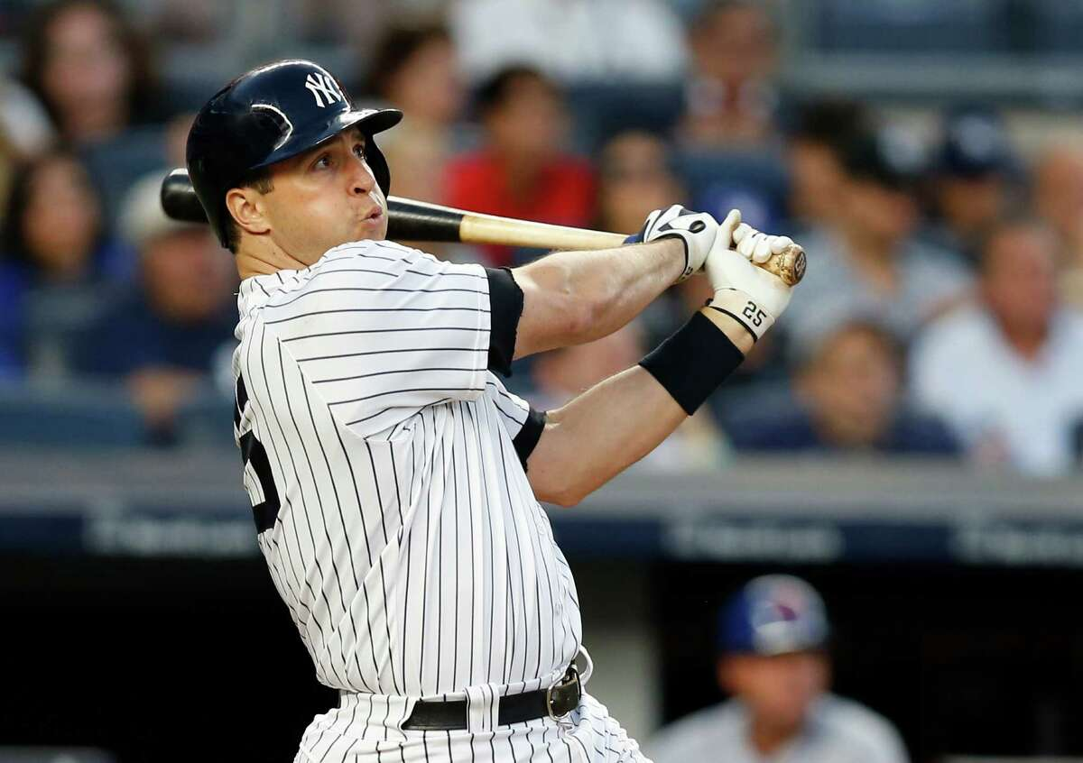 New York Yankees' Mark Teixeira watches his three-run home run off New York Mets starting pitcher Steven Matz during the second inning of a baseball game Wednesday, Aug. 3, 2016, in New York. (AP Photo/Kathy Willens) ORG XMIT: NYY110