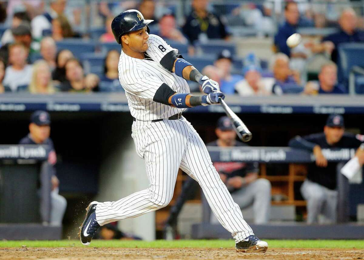 NEW YORK, NY - AUGUST 05: Starlin Castro #14 of the New York Yankees connects on a third inning grand slam home run against the Cleveland Indians at Yankee Stadium on August 5, 2016 in the Bronx borough of New York City. (Photo by Jim McIsaac/Getty Images) ORG XMIT: 607682911