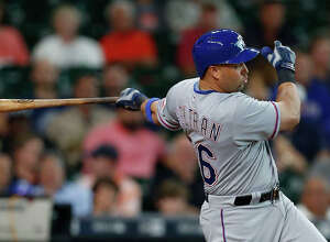 Texas Rangers right fielder Carlos Beltran (36) hits a double during the first inning of an MLB game at Minute Maid Park, Friday, Aug. 5, 2016, in Houston. ( Karen Warren  / Houston Chronicle )