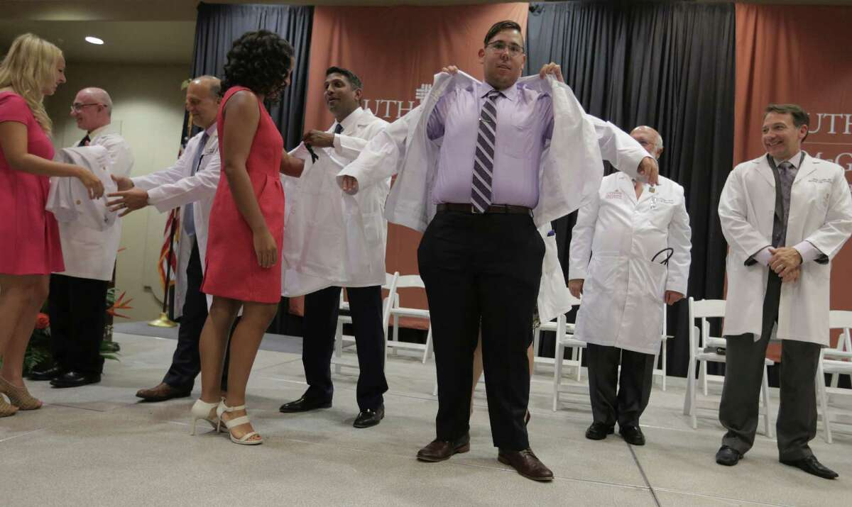 McGovern Medical School at UTHealth first-year students participate in the white coat ceremony to kick off their medical school career on Thursday, July 28, 2016, in Houston.
