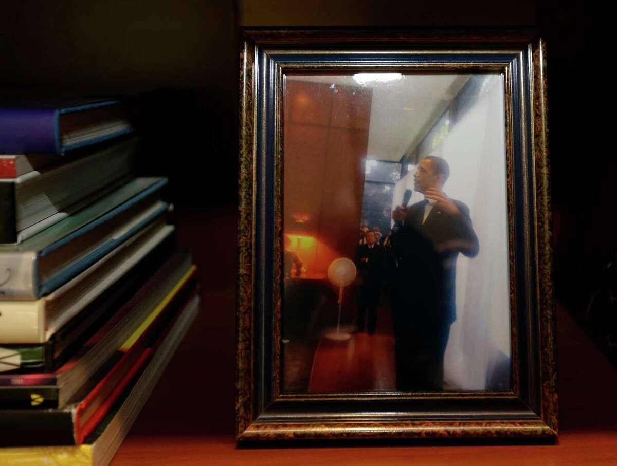 A 2008 photo of President Barack Obama speaking in the River Oaks' home of Richard Mithoff is shown displayed on a shelf Tuesday, July 26, 2016, in Houston. ( Melissa Phillip / Houston Chronicle )