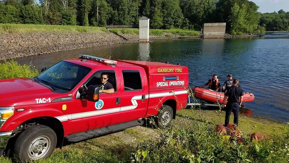 Danbury firefighters rescued four teens who became stranded on an island in the West Lake Reservoir on Friday, Aug. 6, 2016. Photo: Contributed Photo / Contributed Photo