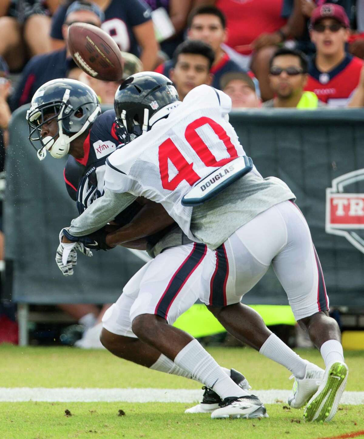 Houston Texans defensive back Duke Thomas (40) breaks up a pass intended for wide receiver Quenton Bundrage during Texans training camp at Houston Methodist Training Center on Saturday, Aug. 6, 2016, in Houston.