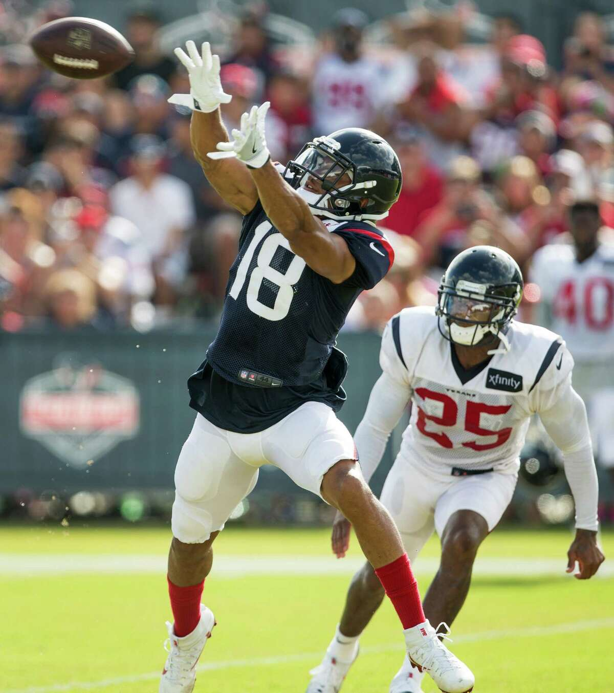 Houston Texans wide receiver Cecil Shorts (18) reaches up to make a catch witih cornerback Kareem Jackson (25) defending during Texans training camp at Houston Methodist Training Center on Saturday, Aug. 6, 2016, in Houston.