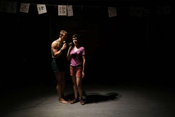 "Ryan Patrick Welsh (left) and Margaret McCarthy in the short play, ""My Dore Alley weekend as represented by the San Francisco Neo-Futurists and some food."""