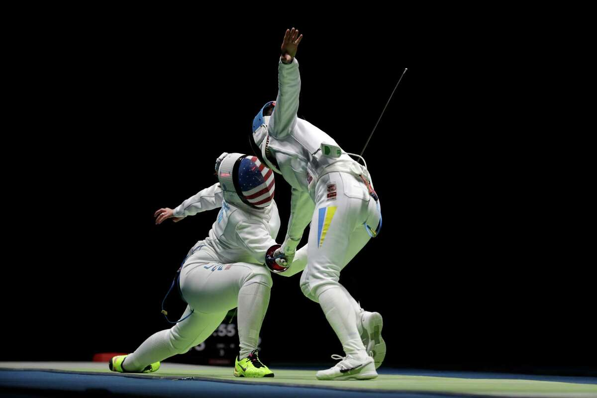 The Hurley sisters, who are from San Antonio but train in Houston, saw their dreams of individual Olympic gold medals end Saturday when Kelley, left, lost to Nathalie Moellhausen of Brazil and an unmasked Courtney, right, fell to Yana Shemyakina of Ukraine in the women's epee round of 32.