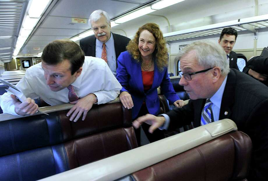 From left U.S. Sen. Chris Murphy, state Rep. Bob Godfrey, U.S. Rep Elizabeth Esty and Bethel First Selectman Matt Knickerbocker, look outside the window as the train moves through Bethel. The group are taking the 9:05 a.m. out of Danbury to Norwalk to talk to comuters about rail transportation issues, Friday, April 1, 2016. Photo: Carol Kaliff / Hearst Connecticut Media / The News-Times