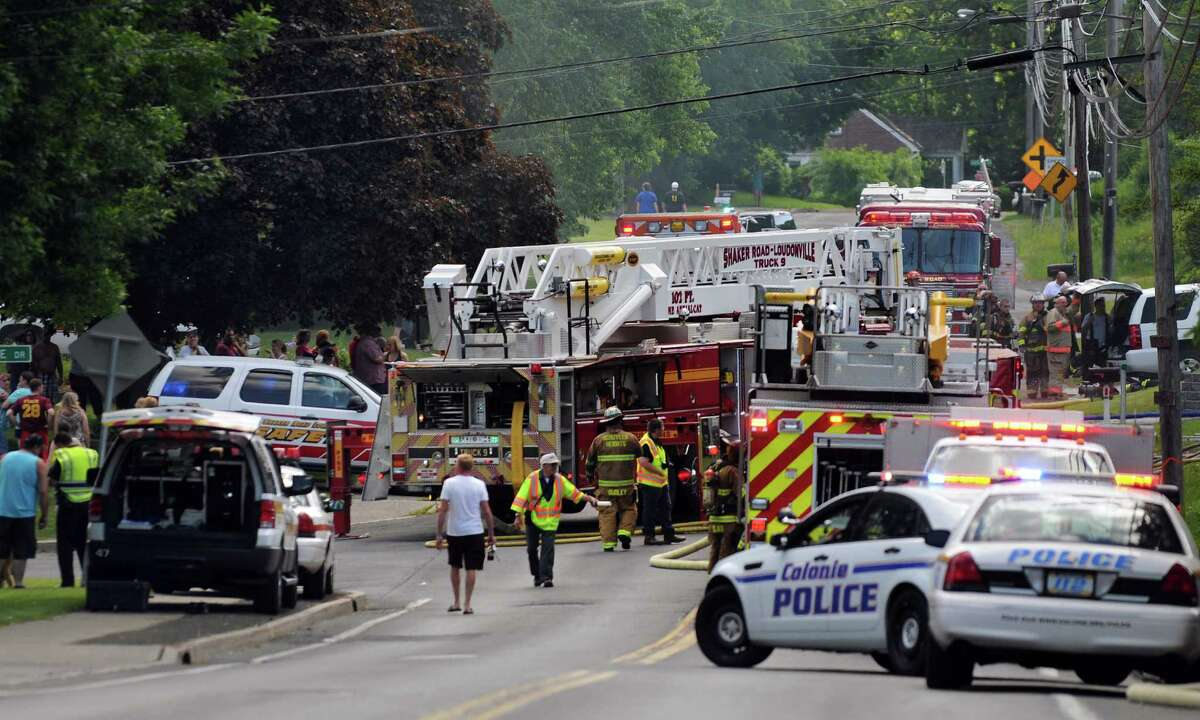 Emergency vehicles fill the road as firefighters work to contain a fire at 217 Osborne Rd. on Saturday, June 7, 2014, in Colonie, N.Y. (Cindy Schultz / Times Union)