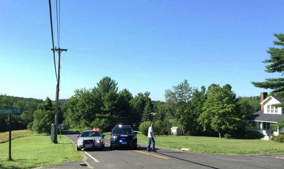 Police and State Troopesr close Main Street S (Rt 133) at Stuart Road E and Stuart Road W in Bridgewater, Conn, on Thursday, August 4, 2016. Photo: H. John Voorhees III