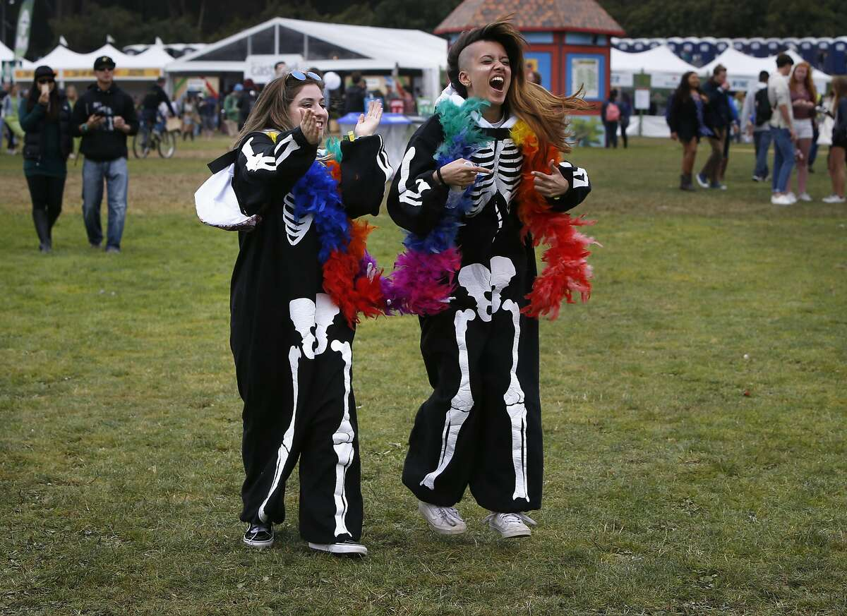 Desiree Sanotos, (left) of Hayward and Aditi Kumar, of Union City dressed as skeltons during day two of the Outside Lands Music Festival in Golden Gate Park in San Francisco on Sat. Aug. 6, 2016.