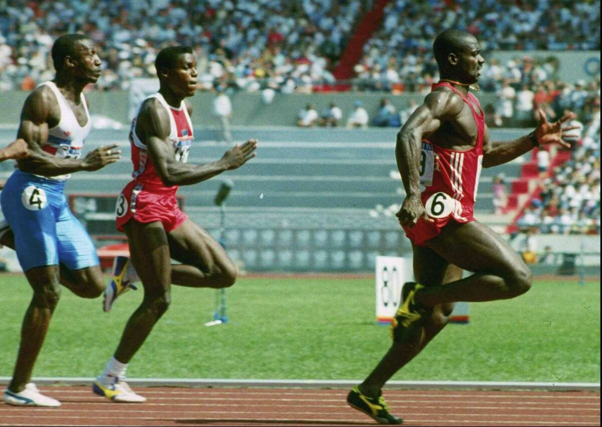 ADVANCE FOR WEEKEND JUNE 22-23 FILE--Ben Johnson of Canada, right, leads the pack to win the 100-meter dash finals in Olympic competition Saturday in Seoul. American Carl Lewis is at center and Linford Christie, far left, of Great Britain was third. Johnson was later stripped of his medal (AP Photo/file)