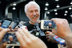San Antonio Spurs coach Gregg Popovich keeps his emotions in check as he addresses the media during a news conference on July 12, 2016, in San Antonio, the day after Tim Duncan announced his retirement.