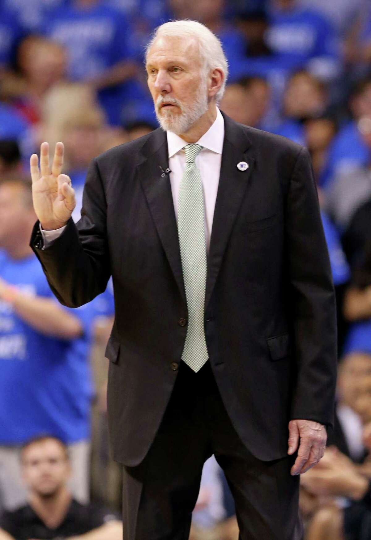 San Antonio Spurs head coach Gregg Popovich calls a play during first half action of Game 6 in the Western Conference semifinals against the Oklahoma City Thunder on May 12, 2016 at Chesapeake Energy Arena.