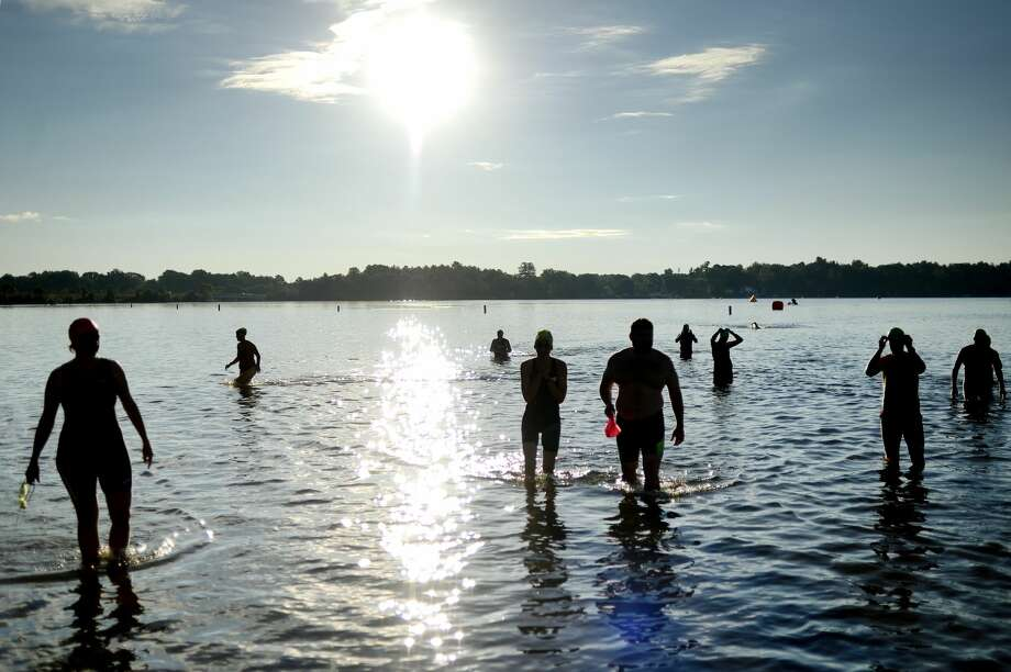NICK KING   nking@mdn.net  Racers test the water before the start of the Sanford and Sun Triathlon and Duathlon on Saturday at Sanford Lake Park. This year marks the 10th anniversary of the event. Photo: NICK KING   Nking@mdn.net