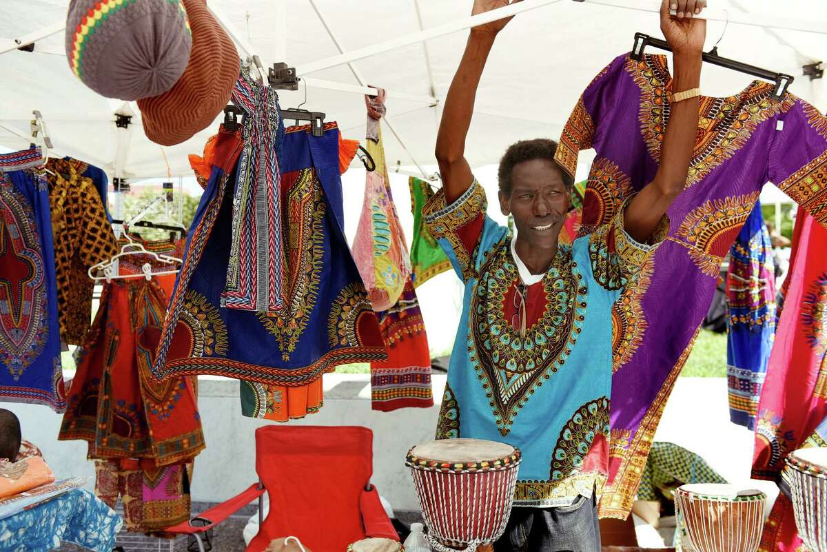 Badara Diagne, shop owner of Nine Steps Away to Africa in Troy, tends his booth during the Black Arts and Cultural Festival on Saturday, Aug. 6, 2016, at the Empire State Plaza in Albany, N.Y. (Cindy Schultz / Times Union)