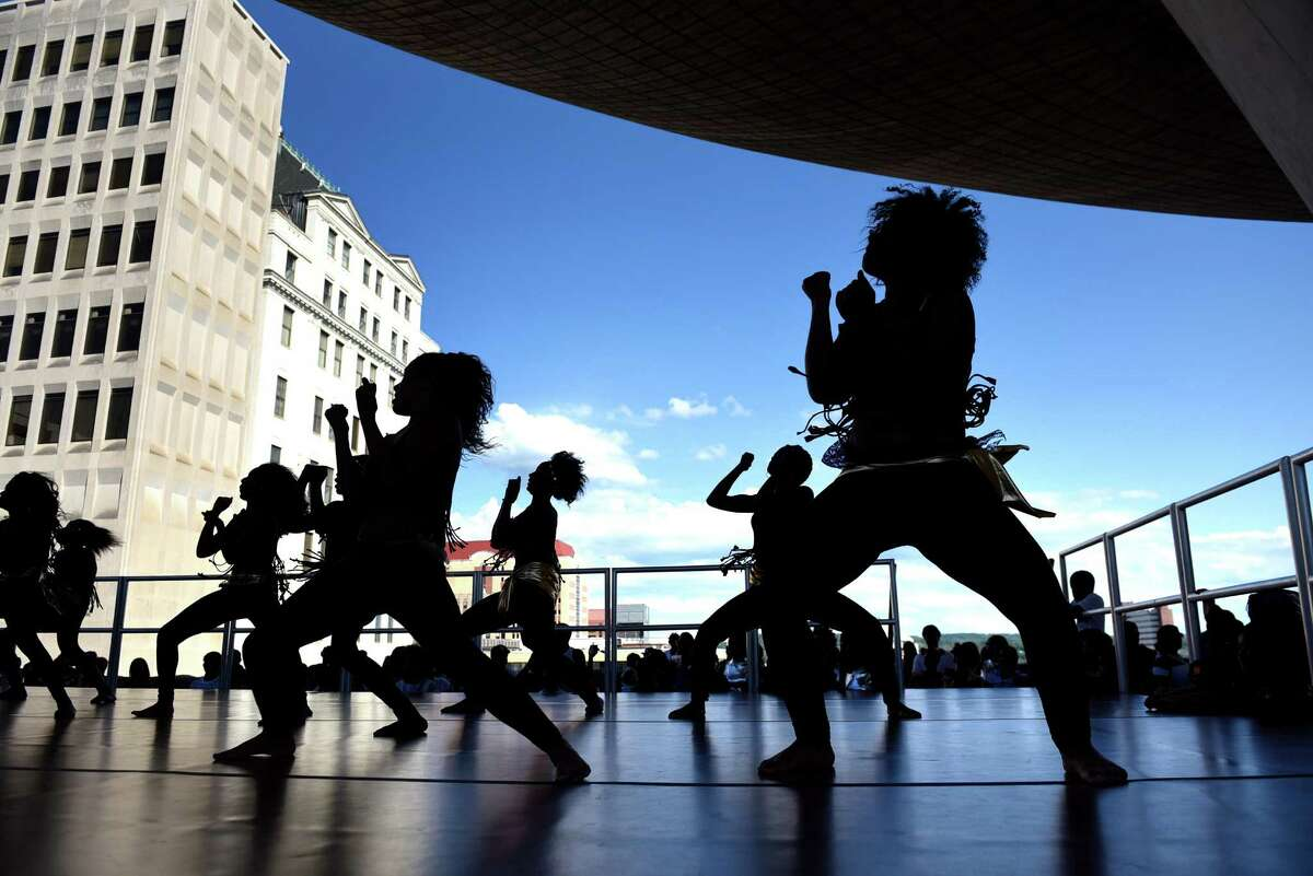Dynasti, an Arbor Hill community dance troupe for girls ages 7 to 19, perform in the shadow of The Egg during the Black Arts and Cultural Festival on Saturday, Aug. 6, 2016, at the Empire State Plaza in Albany, N.Y. (Cindy Schultz / Times Union)