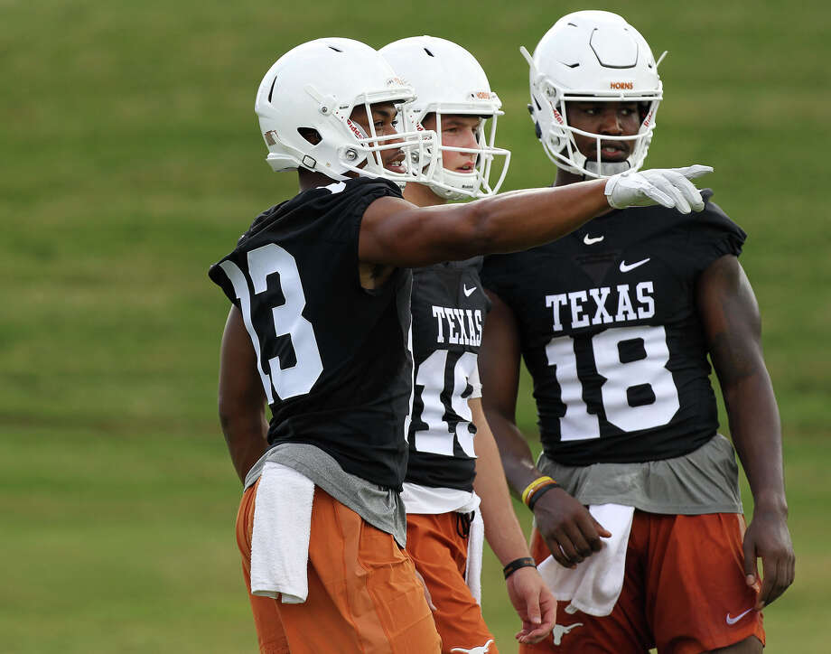Texas quarterbacks Jerrod Heard(13), Matthew Merrick(19) and Tyrone Swoopes(18) speak during preseason practice in Austin, Saturday, Aug. 6, 2016. (Stephen Spillman / for Express-News) Photo: Stephen Spillman / Stephen Spillman