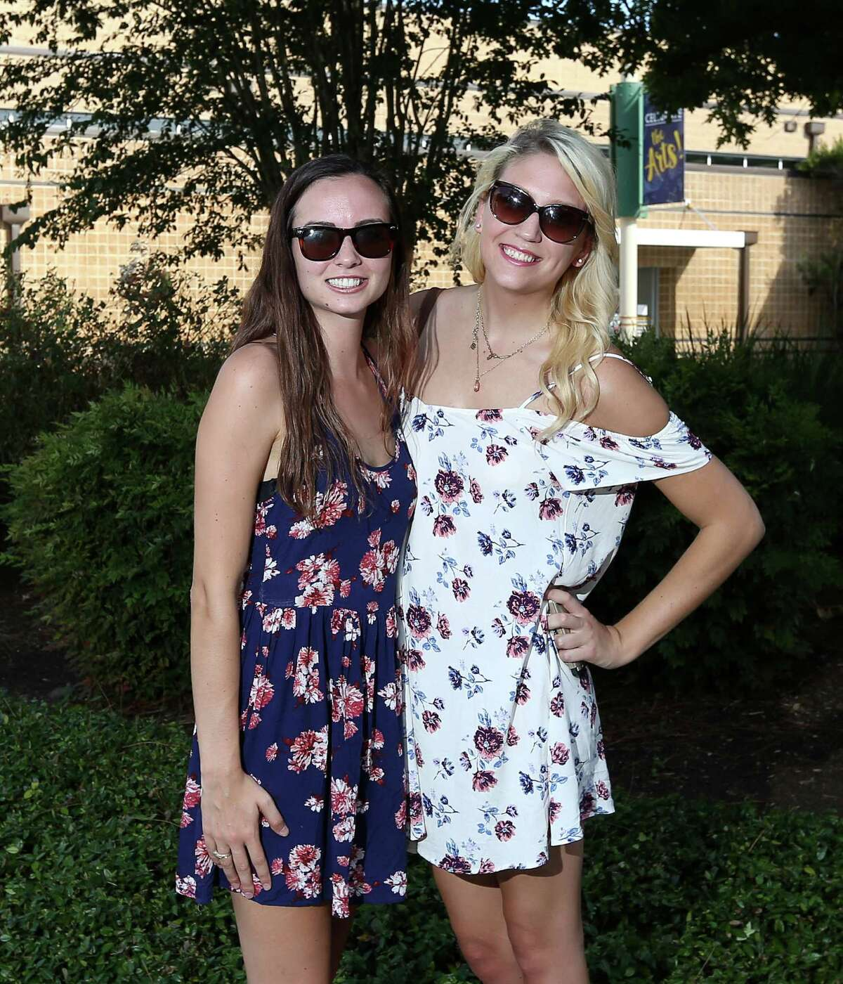 People pose for a photo before the Dixie Chicks concert at the Cynthia Woods Mitchell Pavilion, Saturday, Aug. 6, 2016, in The Woodlands.