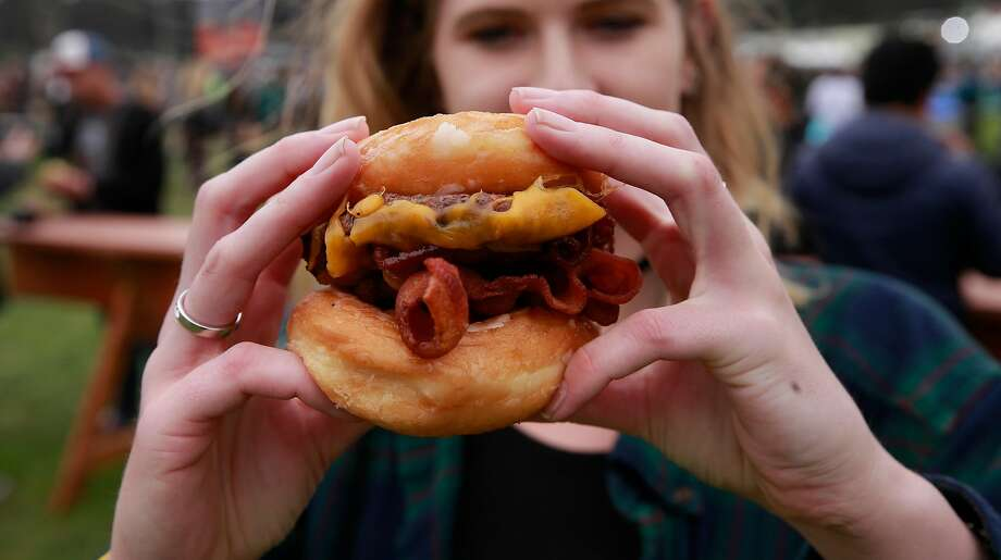 Straw Carnival Fare of Hayes Valley, in San Francisco is serving up The Ringmaster a glazed donuts cheeseburger during day two of the Outside Lands Music Festival in Golden Gate Park in San Francisco, California, on Sat. Aug. 6, 2016. Photo: Michael Macor, The Chronicle