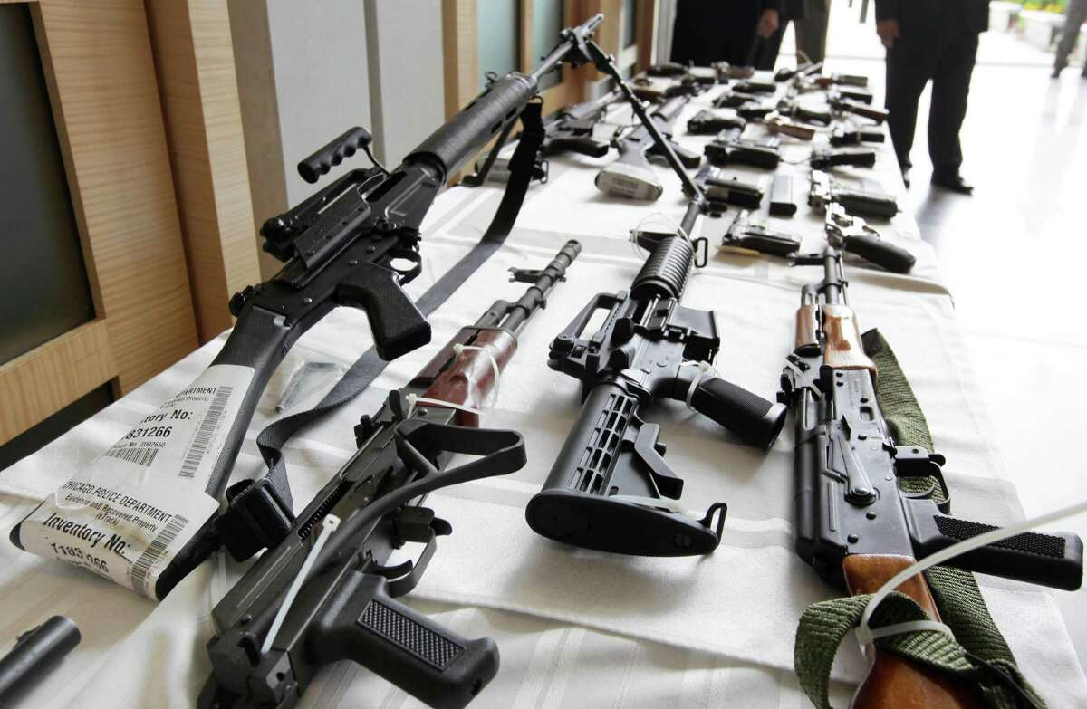 FILE - In this July 22, 2010, file photo, various guns are displayed at the Chicago FBI office. A new poll shows most young adults across racial and ethnic groups support tighter gun polices including background checks, stricter penalties for gun law violations, and banning semi-automatic weapons. In the new GenForward poll, about 9 in 10 young adults say they support criminal background checks for all gun sales, a level of support that remains consistent across racial and ethnic groups.(AP Photo/M. Spencer Green, File) ORG XMIT: WX201