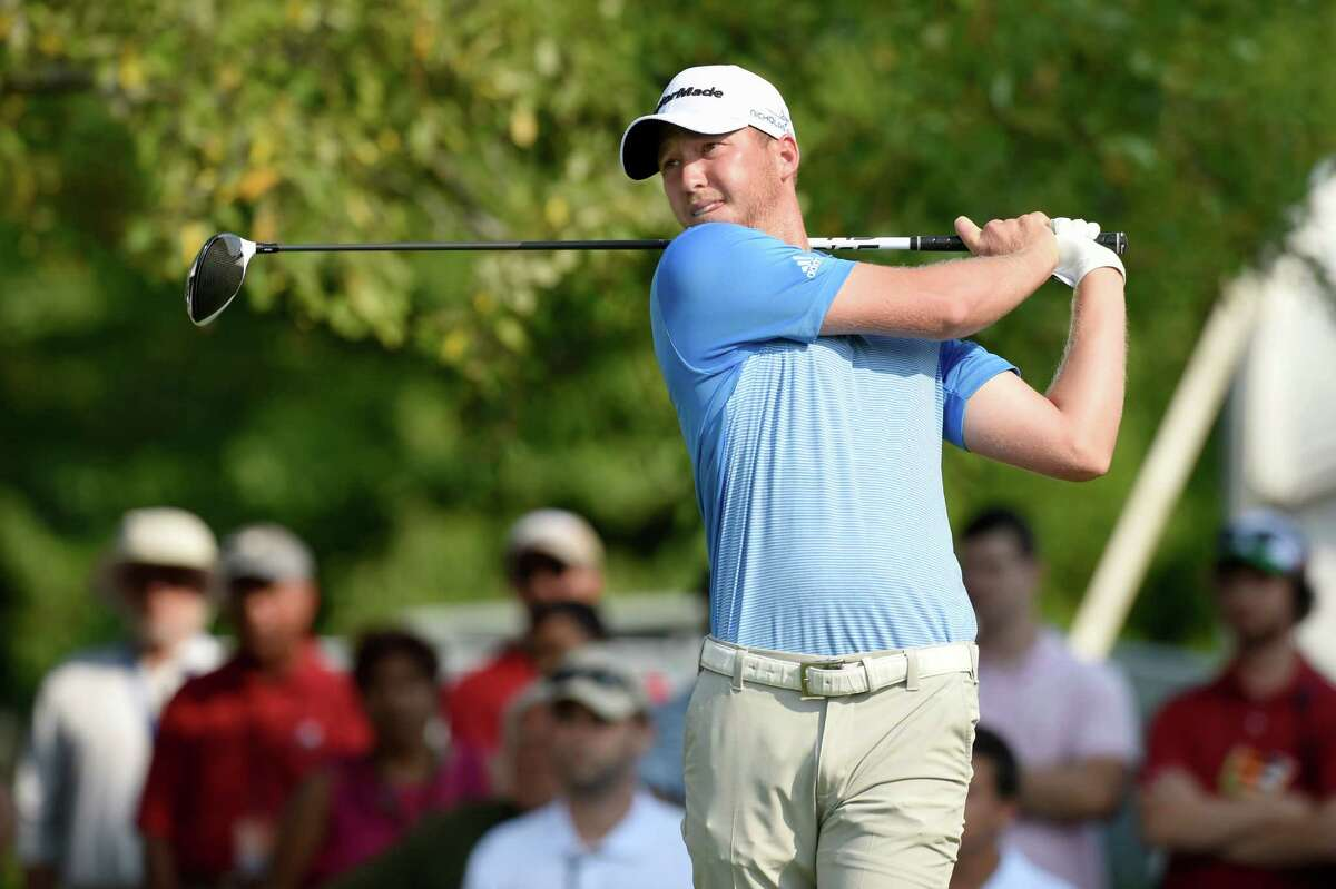 Daniel Berger watches his tee shot on the first hole during the third round of the Travelers Championship golf tournament at TPC River Highlands Saturday, Aug. 6, 2016 in Cromwell, Conn. (John Woike/Hartford Courant via AP) MANDATORY CREDIT ORG XMIT: CTHAR308