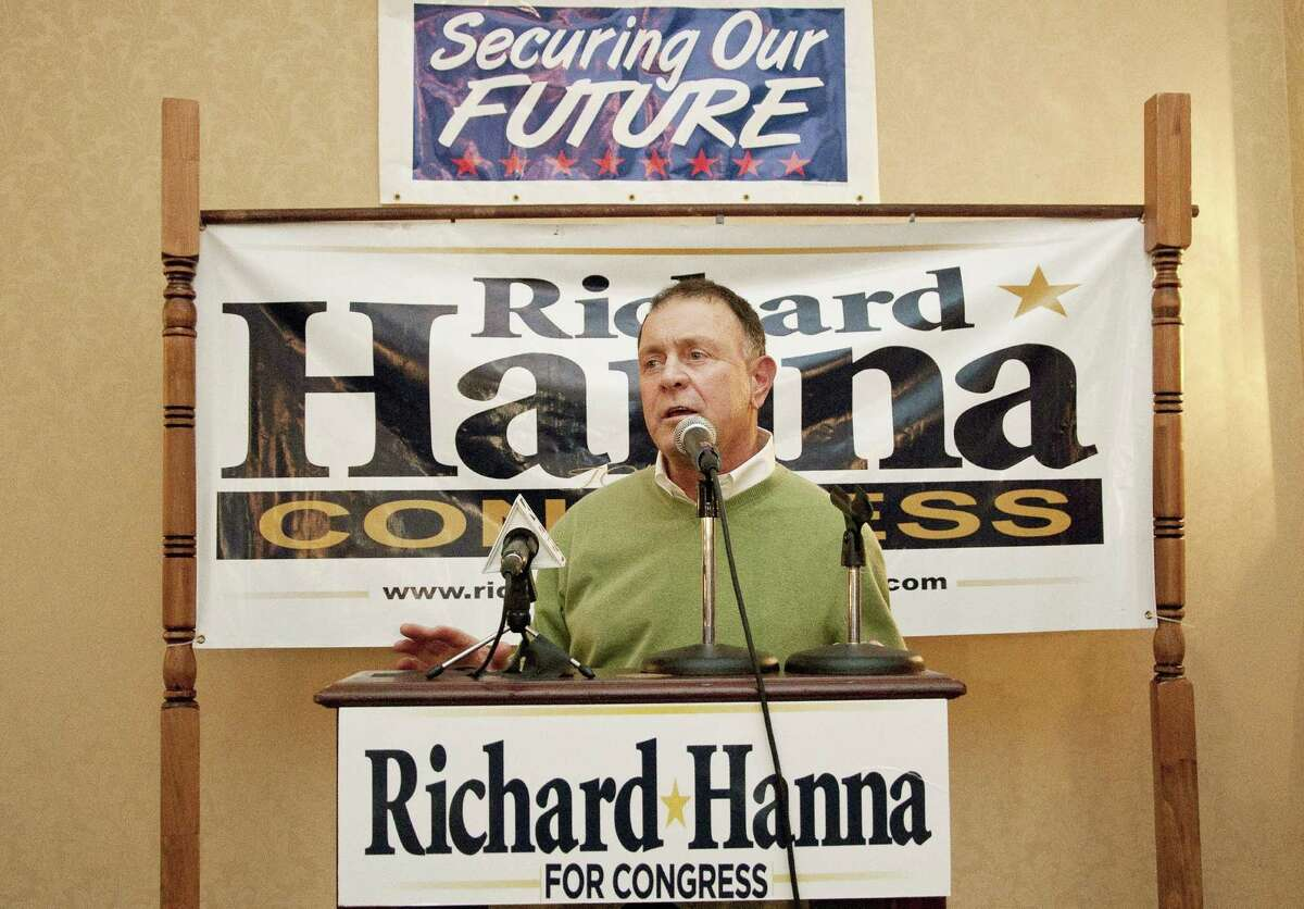 FILE - In this Wednesday, Nov. 3, 2010 file photo, Richard Hanna announces that two-term incumbent Michael Arcuri, D-Utica, conceded to Hanna in New York's 24th congressional district race in Utica, N.Y. (AP Photo/Heather Ainsworth, File)
