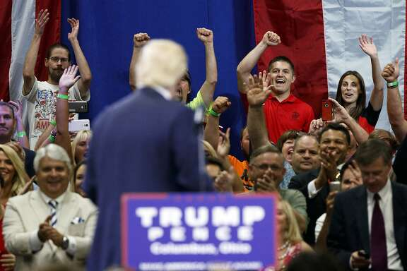 Supporters cheer as Republican presidential candidate Donald Trump speaks during a town hall event, Monday, Aug. 1, 2016, in Columbus, Ohio . (AP Photo/Evan Vucci)