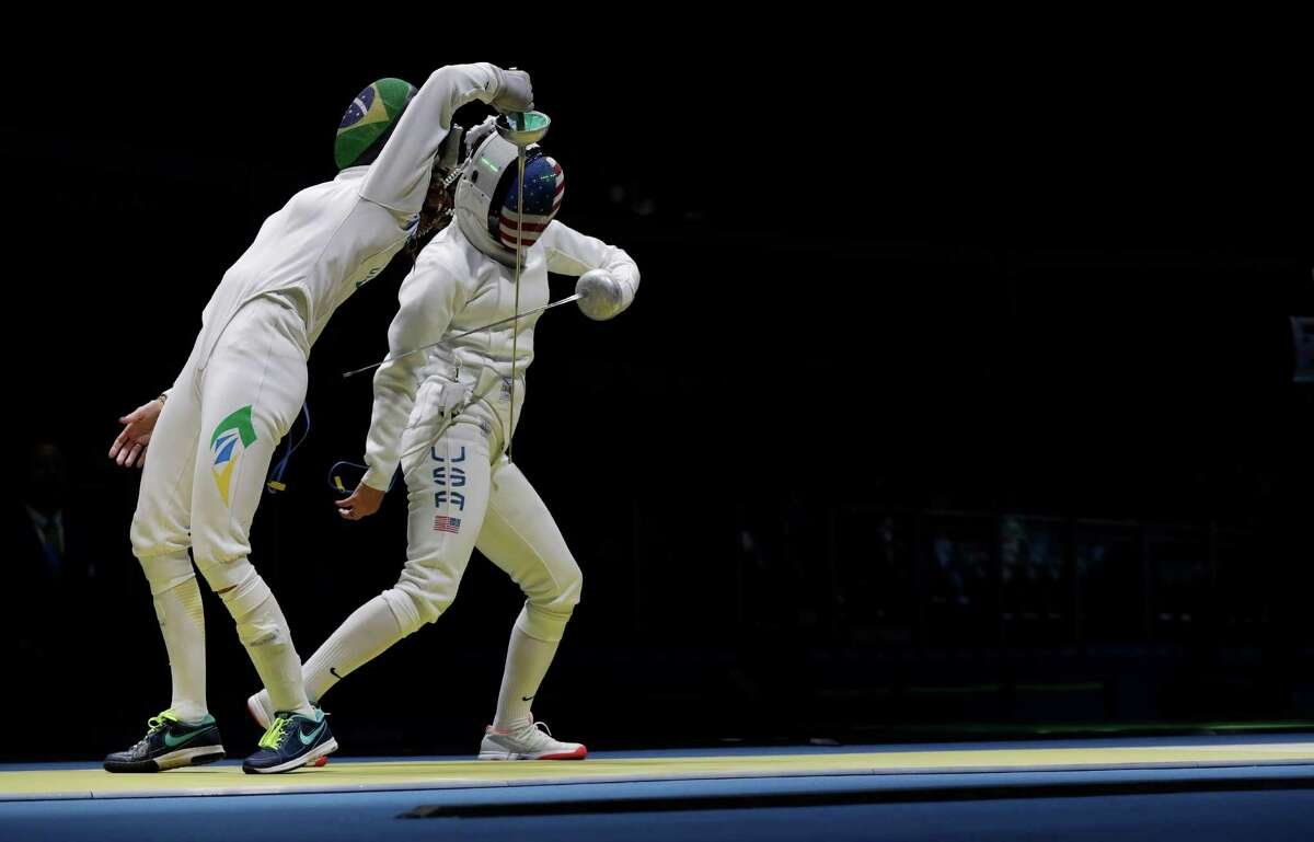 Kelley Hurley of the United States, right, and Nathalie Moellhausen of Brazil compete in the women's individual epee event at the 2016 Summer Olympics in Rio de Janeiro, Brazil, Saturday, Aug. 6, 2016. (AP Photo/Andrew Medichini)