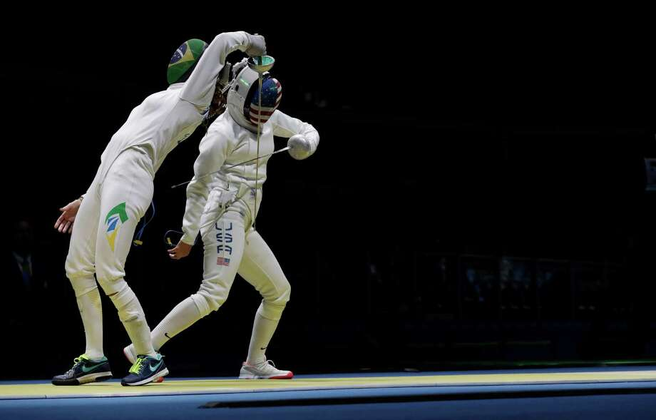 Kelley Hurley of the United States, right, and Nathalie Moellhausen of Brazil compete in the women's individual epee event at the 2016 Summer Olympics in Rio de Janeiro, Brazil, Saturday, Aug. 6, 2016. (AP Photo/Andrew Medichini) Photo: Photos By Andrew Medichini / Associated Press / Copyright 2016 The Associated Press. All rights reserved. This material may not be published, broadcast, rewritten or redistribu