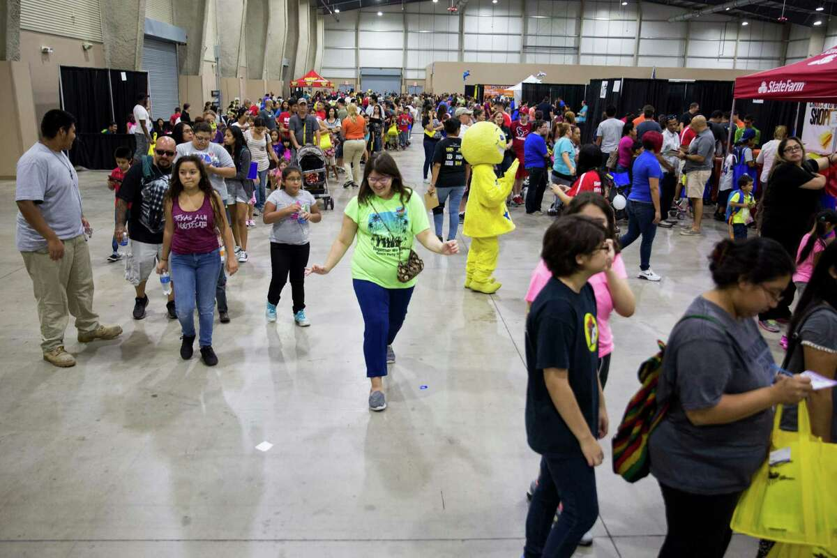 Families walk around the annual Back 2 School Expo presented by Alamo Area Colleges at the Freeman Coliseum Expo Hall earlier this month.