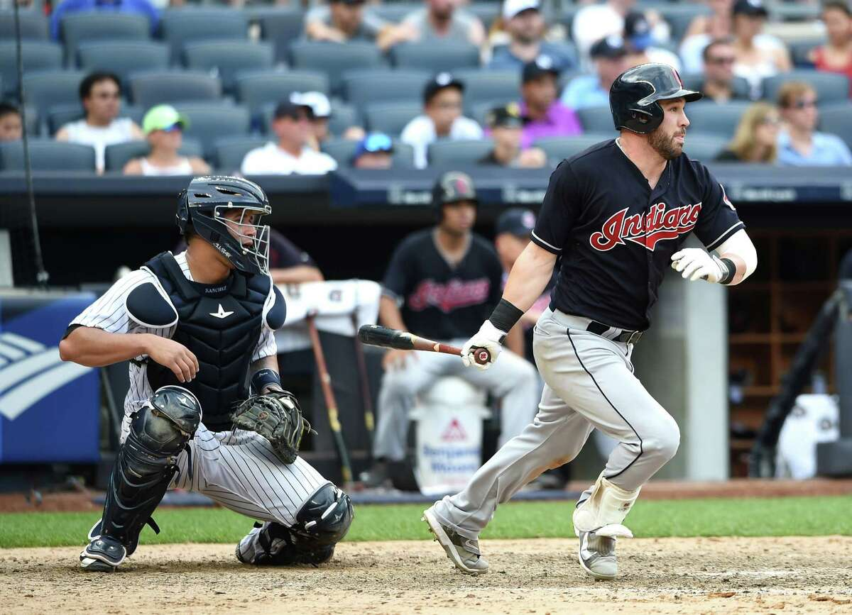 Cleveland Indians Jason Kipnis hits an RBI single off of New York Yankees relief pitcher Nick Goody as Gary Sanchez catches for the Yankees in the ninth inning of a baseball game, Saturday, Aug. 6, 2016, in New York. Kipnis also hit a solo home run during the Indians 5-2 win. (AP Photo/Kathy Kmonicek) ORG XMIT: NYY115