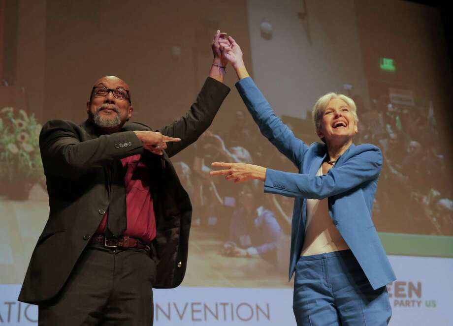 Green Party's presidential candidate Jill Stein and vice president Ajamu Baraka take to the stage after being introduced during the party's national convention on Saturday, Aug. 6, 2016, in Houston. ( Elizabeth Conley / Houston Chronicle ) Photo: Elizabeth Conley, Staff / Houston Chronicle / © 2016 Houston Chronicle