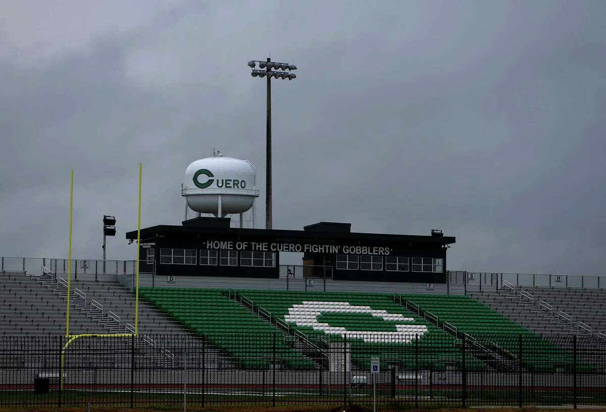 """""""Home of the Cuero Fightin' Gobblers"""" reads the words atop the football stadium on the north side of Cuero, Tuesday, July 26, 2016, in Cuero. Cuero was a stop on the Chisolm Trail in the mid-1800s, and was formerly incorporated in 1873 when the railroad was extended through the area. In recent years the town saw a resurgence with the drilling in the Eagle Ford shale fields before the recent decline in production decimated the burgeoning work force. DeWitt County remains the second largest oil producer in the state but the workforce has been decimated, according to recent industry figures. At the beginning of 2015 there were 27 rigs, each with roughly 100 jobs attached. By the start of 2016 it had slipped to 13. Today there are three. ( Mark Mulligan / Houston Chronicle )"""