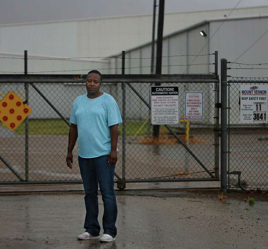 "Tyra Franklin stands near the gate to the Mount Vernon textile mill where she went to work every week for the past 16 years until the mill closed last month, leaving her and almost 300 others without the steady work and benefits they had relied on for years, Tuesday, July 26, 2016, in Cuero. The Mount Vernon Mill was the third largest employer in Cuero, behind the hospital and the school district. Franklin, a single mom, is now looking for work and trying to stay afloat without health insurance. é'Ié•m a true believer in God,é"" said Franklin, é'Ié•m living on prayer right now.é"" ( Mark Mulligan / Houston Chronicle ) Photo: Mark Mulligan, Staff / © 2016 Houston Chronicle"