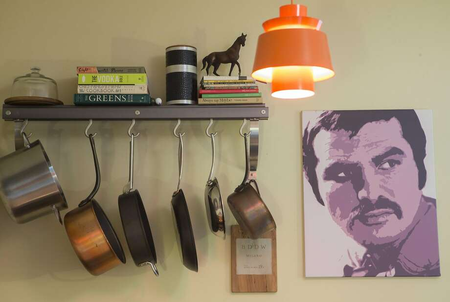 A portrait of Burt Reynolds made by Kelly Waters hangs in the kitchen at the home of Kelly Waters and Peter Judd. Photo: Beck Diefenbach, Special To The Chronicle