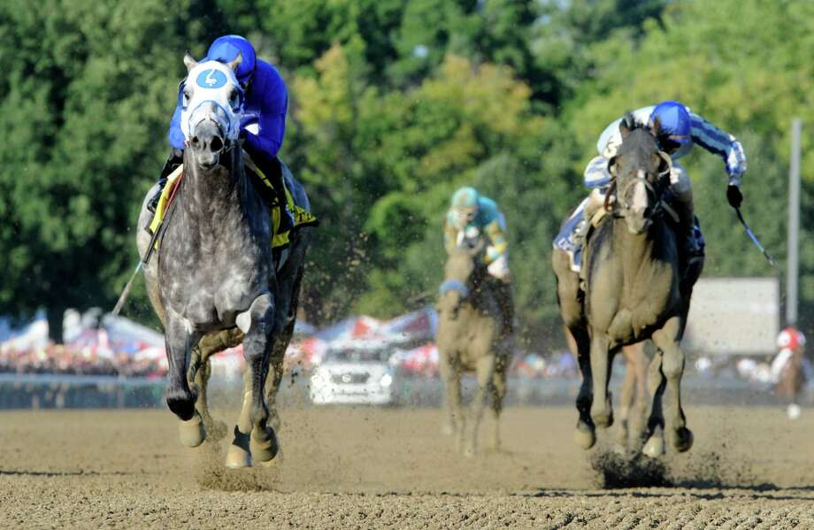 Frosted, left, with jockey Joel Rosario beats the field to win the 89th running of The Whitney Aug. 6, 2016 in Saratoga Springs, N.Y. T (Skip Dickstein/Times Union Photo: SKIP DICKSTEIN