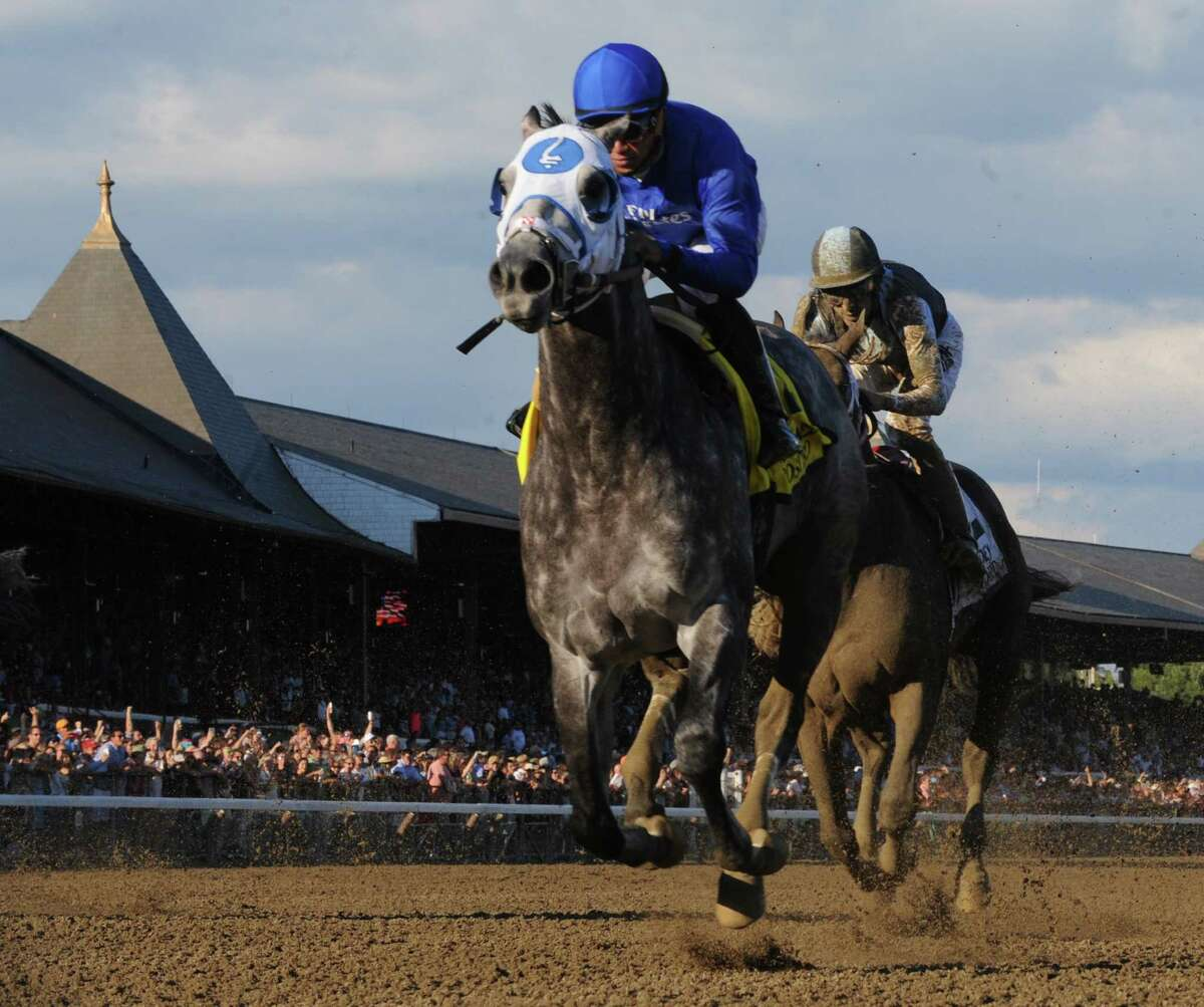 Frosted with jockey Joel Rosario beats the field to win the 89th running of The Whitney Aug. 6, 2016 in Saratoga Springs, N.Y. T (Skip Dickstein/Times Union