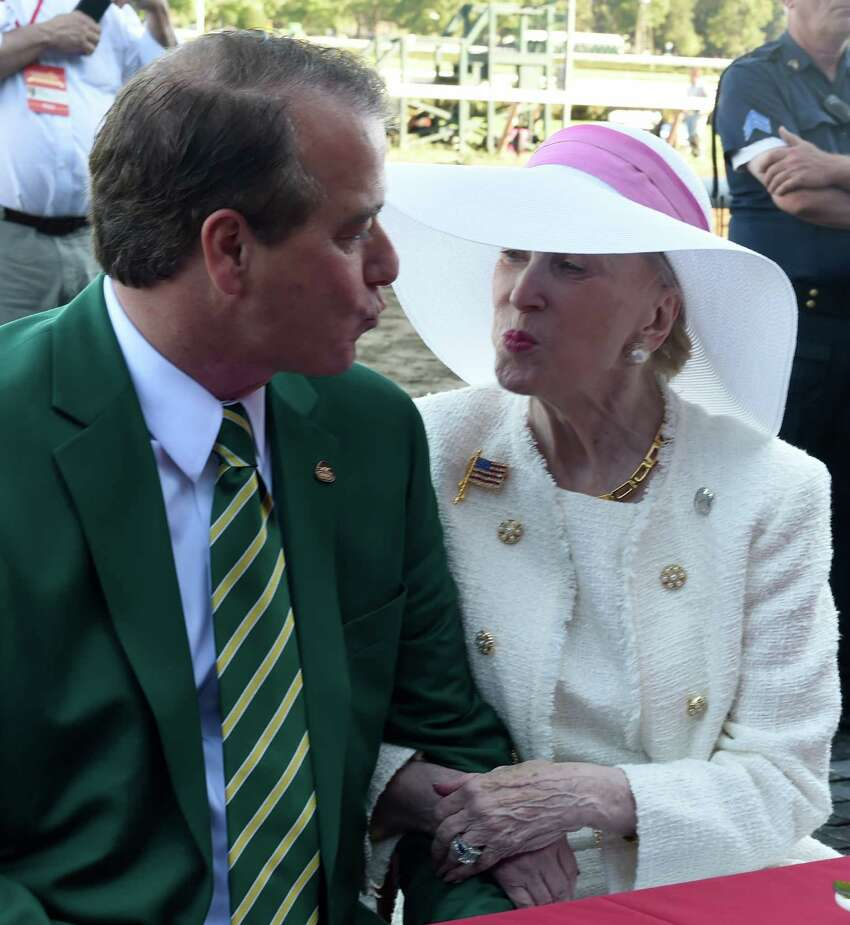 John Hendricksen gives a smooch to his wife Marylou Whitney on the occasion of the celebration of her 90th birthday on the day of the 89th running of The Whitney on Frosted Aug. 6, 2016 in Saratoga Springs, N.Y. T (Skip Dickstein/Times Union